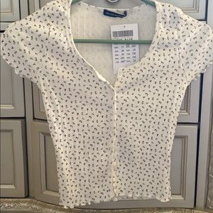 Brandy Melville brand new button up flower tee